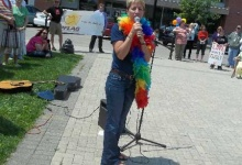 Pastor Kaye speaking at the Racine Pride Parade