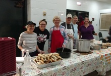 Serving food at the St. Luke's Hot Meal Program
