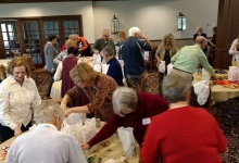 Stuffing bags for Meals on Wheels participants.