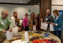 Stuffing goodie bags for Meals on Wheels participants.